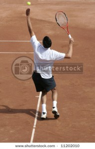 stock-photo-tennis-player-on-hard-court-serving-the-ball-11202010