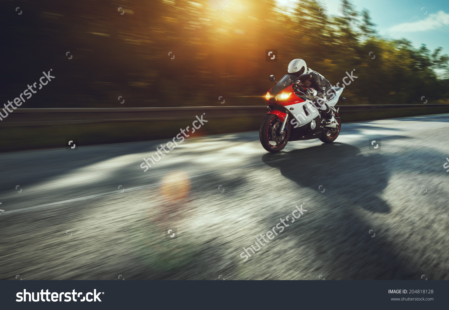 stock-photo-man-riding-motorcycle-in-asphalt-road-204818128